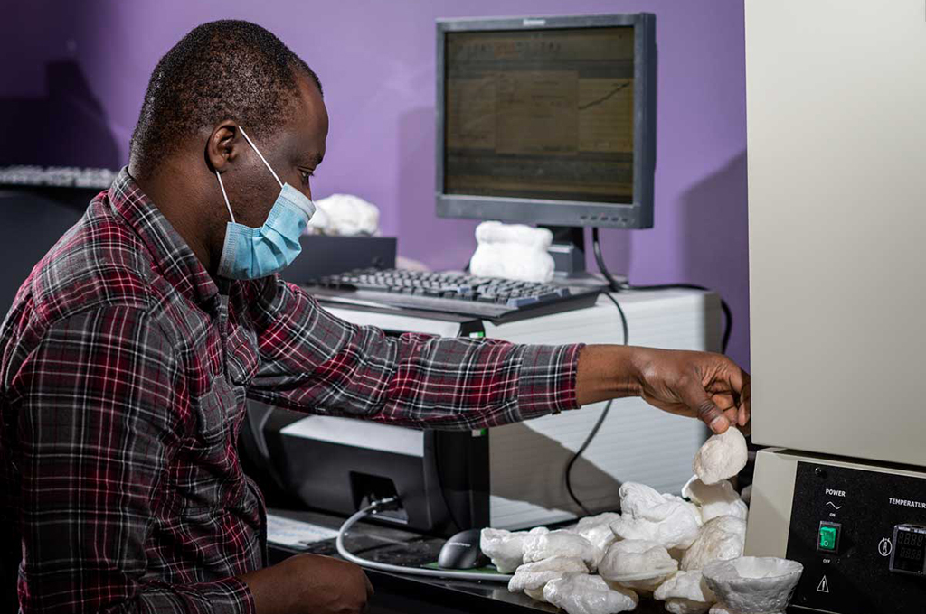 Kayode Oluwabunmi inspects one of the foam prototypes