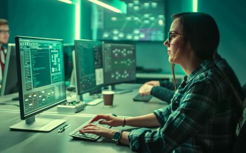 A woman working in front of a computer