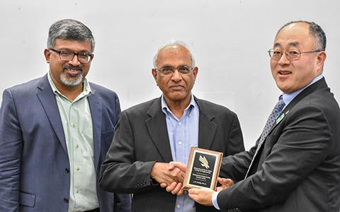 J. N. Reddy, Distinguished Engineering Lecture Series Speaker, is given an award for presenting at UNT.