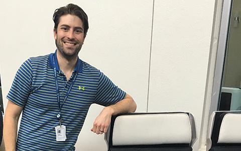Kyle Kayfus leans an elbow against a Safran seat