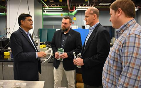 UNT faculty Rajiv Mishra with visitors