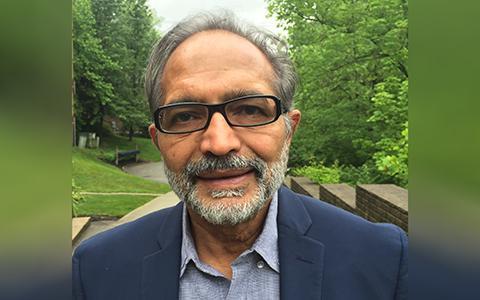Headshot of Vijay Vasudevan outside