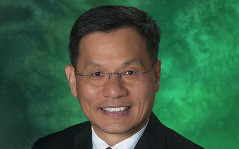 Headshot of Wonbong Choi against a green backdrop