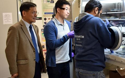Dr. Wonbong Choi with graduate students in the lab