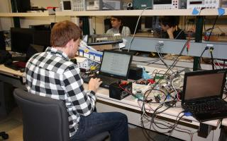 Electrical Engineering senior working in lab